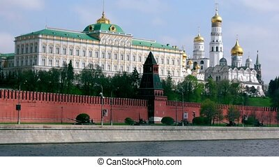Tanks motorcade ride by quay of Moscow Kremlin, red brick...