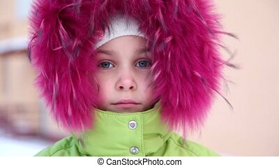 Little girl in fur hood buttoned at collar
