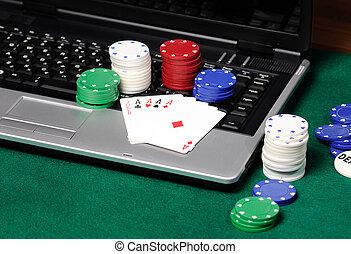 poker cards on a laptop
