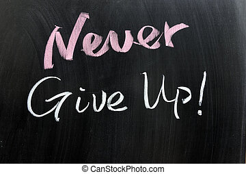 Never give up! - Never give up words written on the...