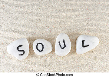 Soul word on group of stones with sand background