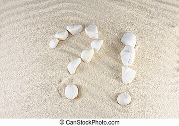 Question and exclamation mark arranged by stones with sand...