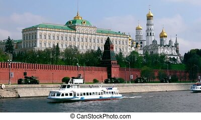 Antiaircraft motorcade ride by quay of Moscow Kremlin, ships sail down the river