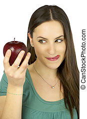 Girl hungry looking at red apple