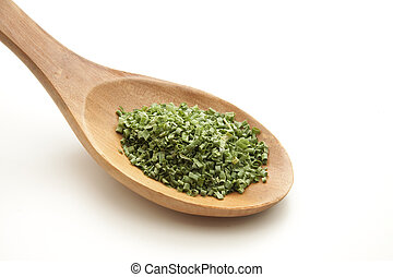 Chives on cooking spoon