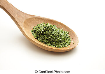 Parsley on cooking spoon
