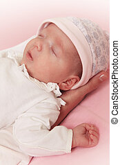 Newborn baby girl - Sleeping newborn baby girl in hands of...