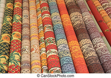 Rolls of Provencal textile on a market stall - Typical...