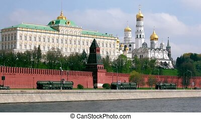 Rockets motorcade ride by quay of Moscow Kremlin, red brick...
