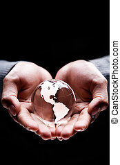 America continent - Hands holding a glass globe showing...