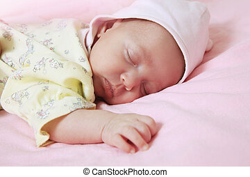 New born baby girl peacefully sleeping