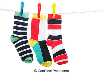 The socks - Three striped socks hanging on the clothesline....