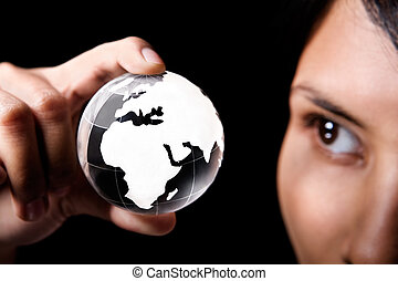 Africa and Europe continent - A woman examining a glass...