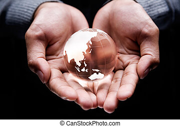 Asia and Australia continent - Hands holding a glass globe...