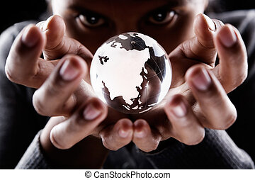 Asia and Australia continent - A woman holding a glass globe...