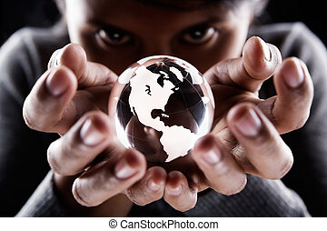 America continent - A woman holding a glass globe with...
