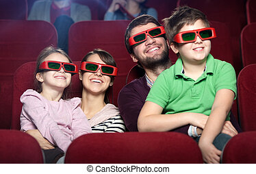 Smiling family in the movie theater - Smiling family in the...