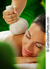 relaxing - portrait of young beautiful woman in spa...