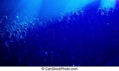 Crowd people at rave party with color light flashes