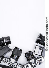 Photojournalism - Cameras over white background, framing the...