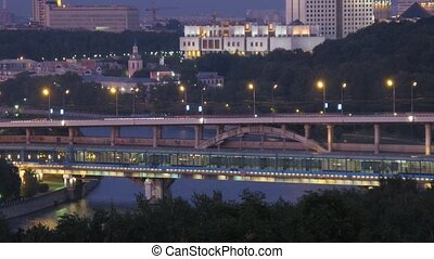 Luzhnetsky bridge through river is shone by lanterns, view...