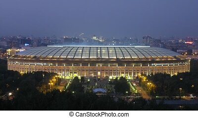 People and cars leave sports complex Luzhniki - MOSCOW -...
