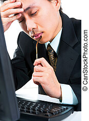 Stress young businessman - Side view of a stress young...