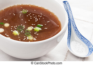 Miso Soup in white bowl with soup spoon