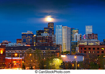 Full Moon Above Denver - Denver skyline at dusk with the...