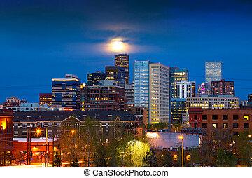 Full Moon Above Denver - Denver skyline at dusk with the...