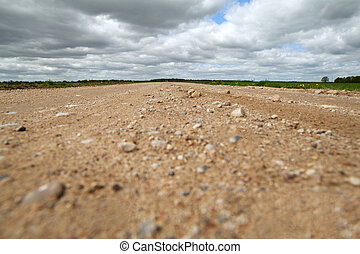 Rural road. - Rural road and cloudy sky.