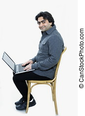 Man with laptop - Solitary man with laptop looking up and...