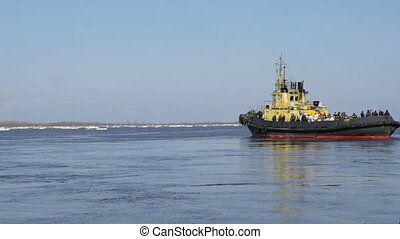 tug boat pushing through ice