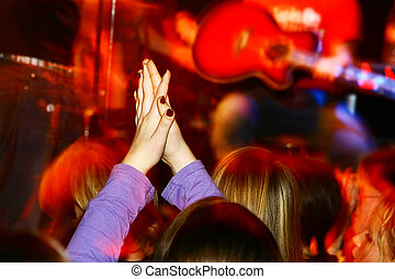 Live Concert - people at a concert applaude an Band,...