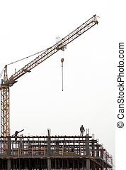Workers on scaffolding on a construction site