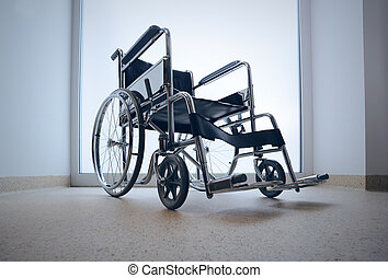 Empty wheelchair parked in hospital hallway