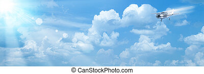 Blue skies with bright sun and airplane as abstract backgrounds