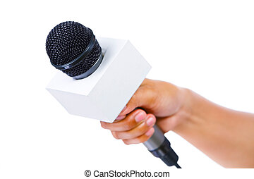 Bare hand holding microphone - Side view of a bare hand...