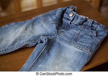 Denim blue jeans pocket on wood table