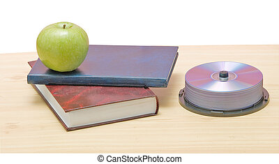 Apple, dvd, and books as a symbol of transition fron old to...