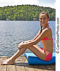 Pretty Preteen at Lake - A pretty preteen girl posing on a...
