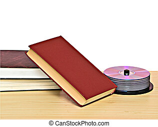 Pile of books and DVD disk pack as symbols of old and new...