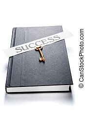 Golden key and success label on book