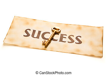 Golden key to success - A golden key placed over an vintage...