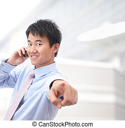 Young smiling business man speaking phone