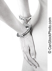 high-key of a handcuffed woman