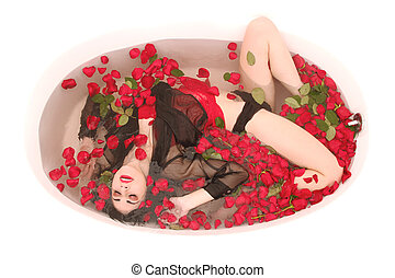 Woman in a Bath Tub Full of Flowers