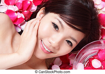 Girl smiling face with rose - Asian beauty Girl smiling face...