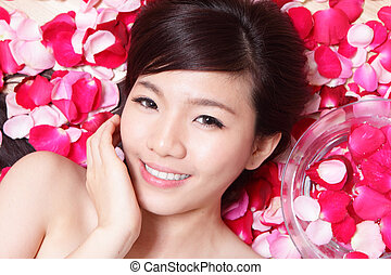 Girl smiling face with rose