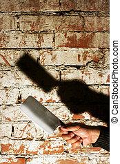 Crime Concept - Crime concept. Hand holding an axe shaped...